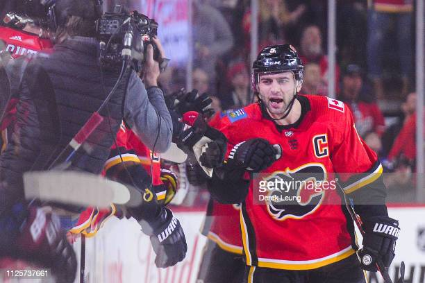 Mark Giordano of the Calgary Flames celebrates with his teammates after scoring against Calvin Pickard of the Arizona Coyotes during an NHL game at...