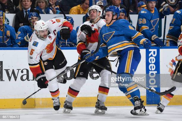 Mark Giordano of the Calgary Flames collides with Ivan Barbashev of the St Louis Blues on March 25 2017 at Scottrade Center in St Louis Missouri