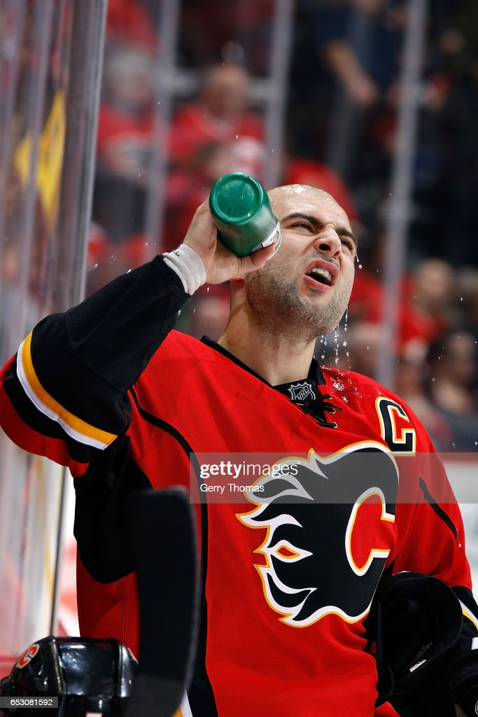 Mark Giordano #5 of the Calgary Flames gets a drink during an NHL game against the Pittsburgh Penguins on March 13, 2017 at the Scotiabank Saddledome in Calgary, Alberta, Canada.