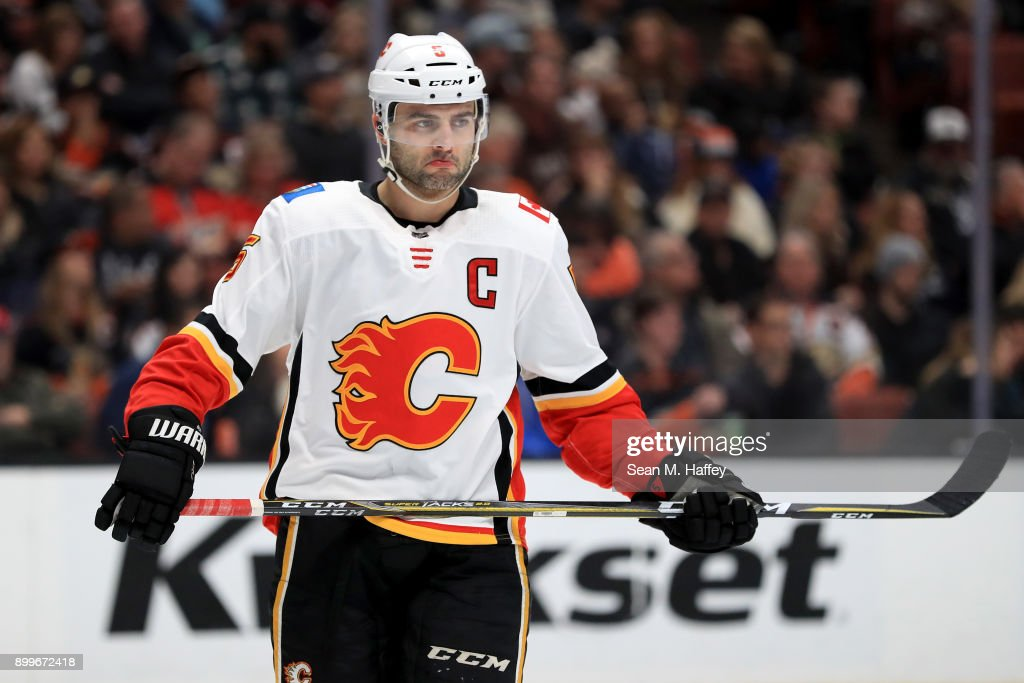 Mark Giordano #5 of the Calgary Flames looks on during the first period of a game against the Anaheim Ducks at Honda Center on December 29, 2017 in Anaheim, California.