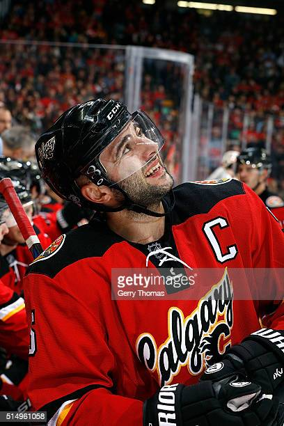 Mark Giordano of the Calgary Flames looks up at the scoreboard during an NHL game against the Arizona Coyotes at Scotiabank Saddledome on March 11...