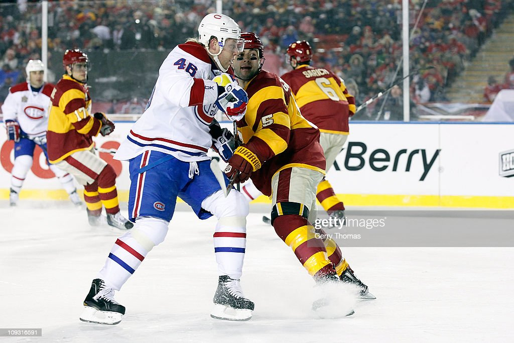 d49c73670 Mark Giordano of the Calgary Flames skates against Andrei Kostitsyn ...