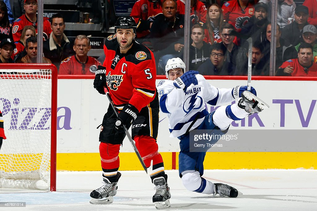 Mark Giordano #5 of the Calgary Flames skates against Tyler Johnson #9 of the Tampa Bay Lightning at Scotiabank Saddledome on October 21, 2014 in Calgary, Alberta, Canada.
