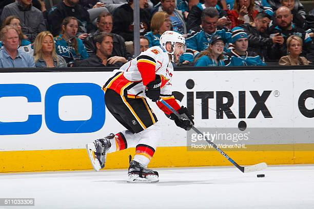 Mark Giordano of the Calgary Flames skates wit hthe puck against the San Jose Sharks at SAP Center on February 11 2016 in San Jose California