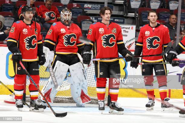 Mark Giordano Sean Monahan and teammates of the Calgary Flames skate before the gam against the San Jose Sharks at Scotiabank Saddledome on February...