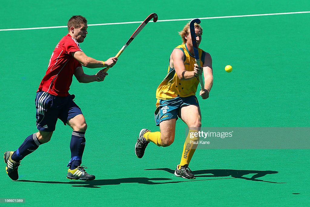 Mark Gleghorne of England and Aran Zalewski of the Kookaburras contest for the ball in the gold medal match between the Australian Kookaburras and England during day four of the 2012 International Super Series at Perth Hockey Stadium on November 25, 2012 in Perth, Australia.