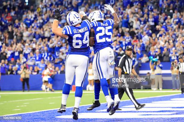 Mark Glowinski and Marlon Mack of the Indianapolis Colts celebrates after a touchdown in the second quarter against the Buffalo Bills at Lucas Oil...