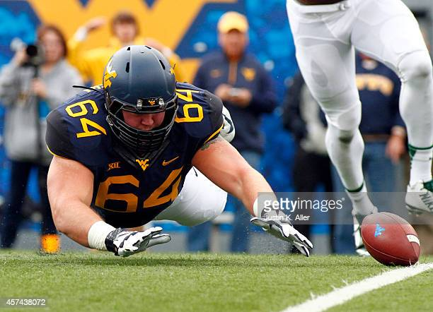 Mark Glowinski of the West Virginia Mountaineers attempts to recover a fumble in the first quarter against the Baylor Bears during the game on...