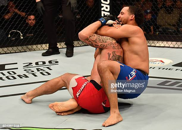 Mark Godbeer of England secures a rear choke submission against Mark Godbeer of England in their heavyweight bout during the UFC Fight Night at the...