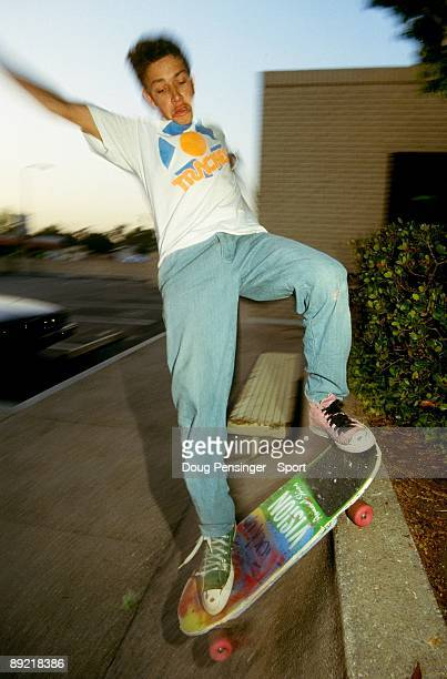 Mark 'Gonz' Gonzalez riding for Vision Skateboards and innovator of street skating grinds a bank as he takes to the streets in June 1985 in Orange...