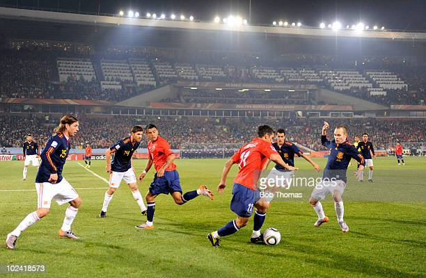 Mark Gonzalez of Chile faced by Sergio Ramos Xabi Alonso Sergio Busquets and Andres Iniesta of Spain during the 2010 FIFA World Cup South Africa...