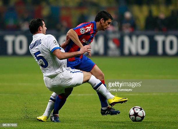 Mark Gonzalez of CSKA Moscow battles for the ball with Dejan Stankovic of FC Internazionale Milano during the UEFA Champions League Quarter Finals,...