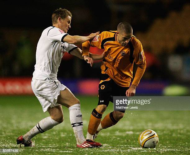 Mark Gower of Swansea tackles Michael Kightly of Wolves during the CocaCola Championship match between Wolverhampton Wanderers and Swansea City at...