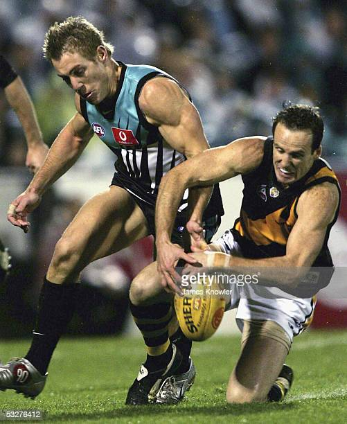Mark Graham of the Tigers and Brett Ebert of Port in action during the round 17 AFL match between Port Adelaide Power and the Richmond Tigers at AAMI...