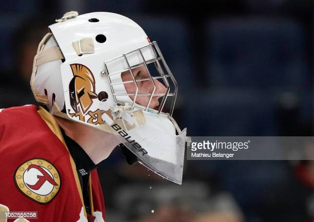Mark Grametbauer of the AcadieBathurst Titan looks at the scoreboard against the Quebec Remparts during their QMJHL hockey game at the Videotron...