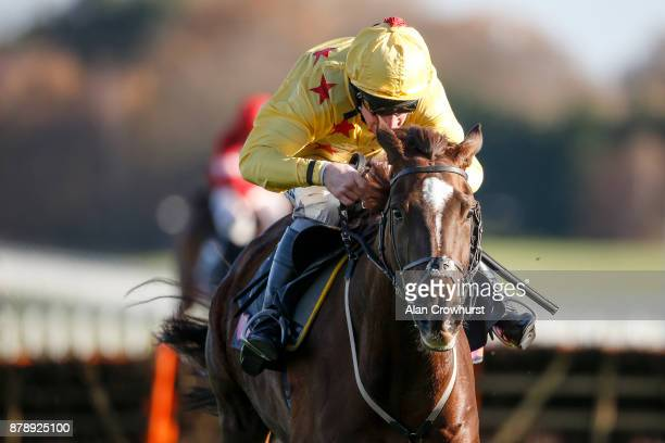 Mark Grant riding Count Meribel clear the last to win The Mitie Events Leisure Novicesâ Hurdle Race at Ascot racecourse on November 25 2017 in Ascot...