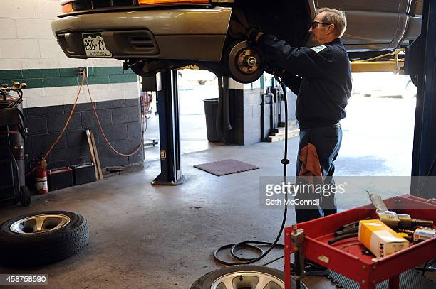 Mark Greene removes the brakes from a truck as he prepares to replace them at Mark Greene Automotive Repair in Lakewood Colorado on November 5 2014...