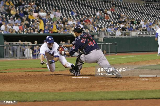 Mark Grudzielanek of the Royals is tagged out by Indians catcher Victor Martinez during action between the Cleveland Indians and Kansas City Royals...
