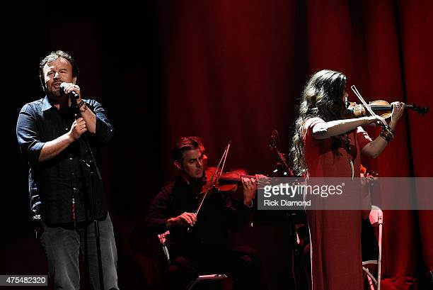 Mark Hall and Melodee Devevo of muscial group Casting Crowns perform onstage during the 3rd Annual KLOVE Fan Awards at the Grand Ole Opry House on...