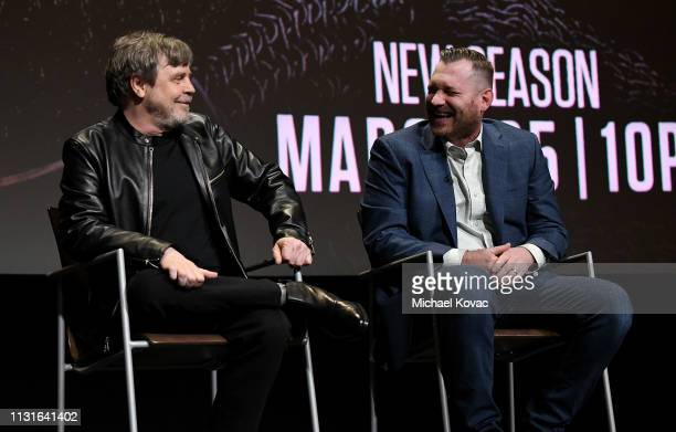 Mark Hamill and Aaron Helbing speak onstage at the Knightfall For Your Consideration Event in Los Angeles on March 19 2019 in Los Angeles California