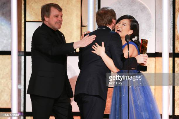 Mark Hamill and Kelly Marie Tran present RianÊJohnson the award for Best Movie for Grownups at AARP's 17th Annual Movies For Grownups Awards at the...