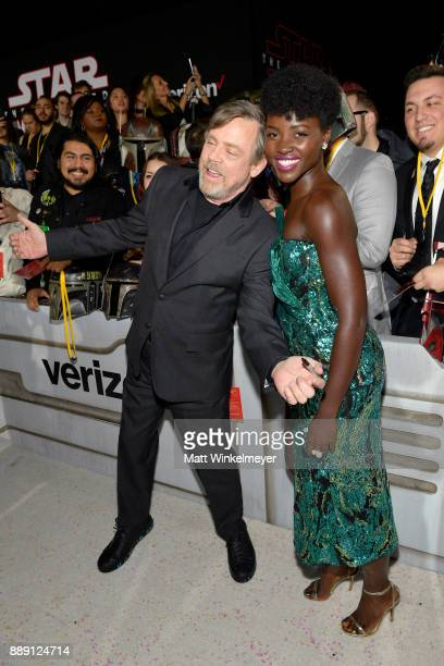 Mark Hamill and Lupita Nyong'o attend the premiere of Disney Pictures and Lucasfilm's 'Star Wars The Last Jedi' at The Shrine Auditorium on December...