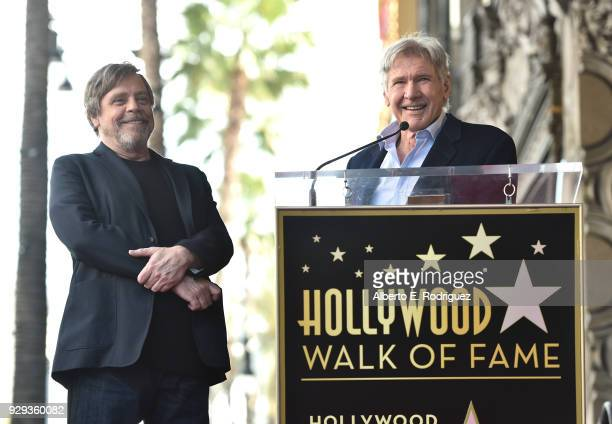Mark Hamill is honored with a star by Harrison Ford on the Hollywood Walk of Fame on March 8 2018 in Hollywood California