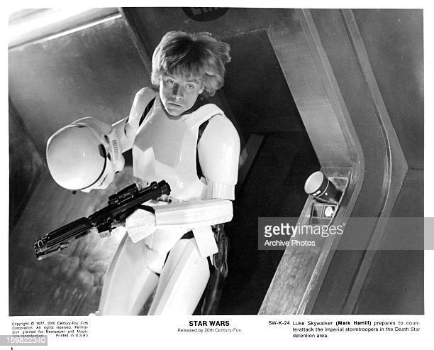 Mark Hamill takes off his storm trooper helmet in a scene from the film 'Star Wars' 1977