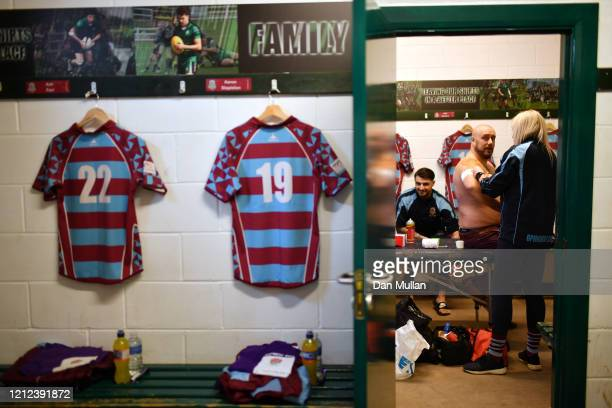 Mark Hardie of OPMs gets strapping applied in the changing room prior to the Lockie Cup Semi Final match between Old Plymouthian and Mannameadians...