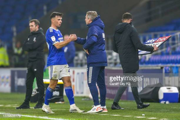Mark Harris and Neil Harris, Manager of Cardiff City during the Sky Bet Championship match between Cardiff City and Luton Town at Cardiff City...