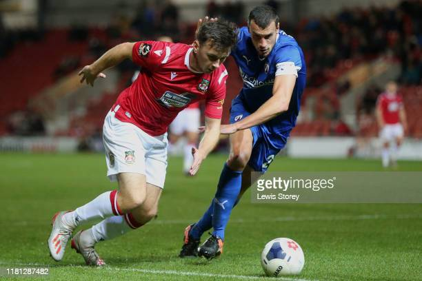Mark Harris battles for possession with Hayden Hollis during the Vanarama National League match between Wrexham and Chesterfield at the Racecourse...