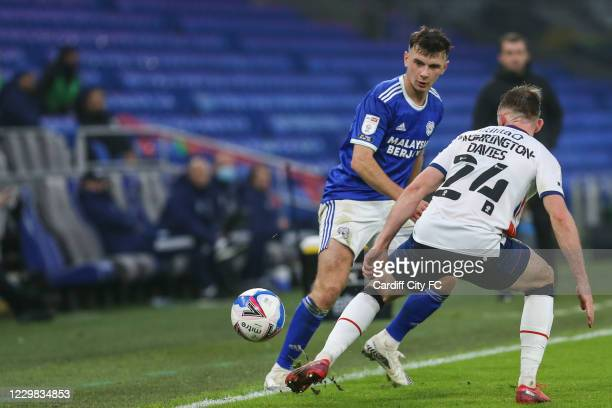 Mark Harris of Cardiff City FC and Rhys Norrington-Davies of Luton Town during the Sky Bet Championship match between Cardiff City and Luton Town at...