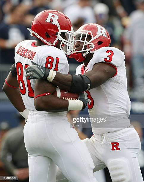 Mark Harrison of the Rutgers Scarlet Knights celebrates his touchdown with teammate Shamar Graves in the second half against the Connecticut Huskies...
