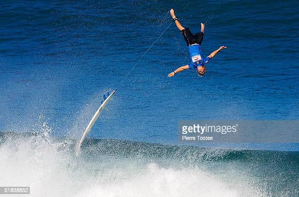 Mark Healey wipes out during the Rip Curl Pipe Masters December 8 2004 at Pipeline of the North Shore of Oahu Hawaii