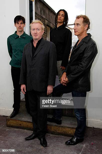 Mark Heaney Andy Gill Thomas Mcneice and Jon King of the band Gang Of Four pose at The Macbeth on August 24 2009 in London England