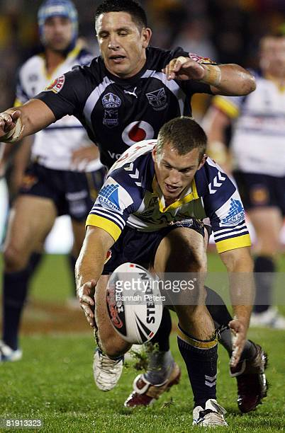 Mark Henry of the Cowboys tries to retain the ball as Steve Price of the Warriors closes in during the round 18 NRL match between the Warriors and...
