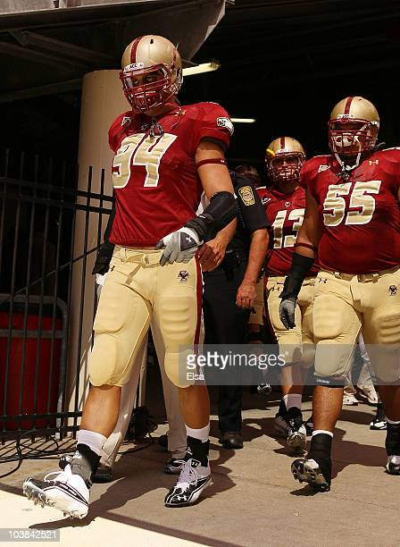 Mark Herzlich, Damik Scafe and Codi Boek of the Boston College Eagles walk out to the field for the home opening game against the Weber State...