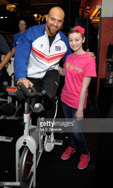 Mark Herzlich poses with a fan at 2012 Cycle For Survival - Day 2 at Equinox Graybar on February 12, 2012 in New York City.