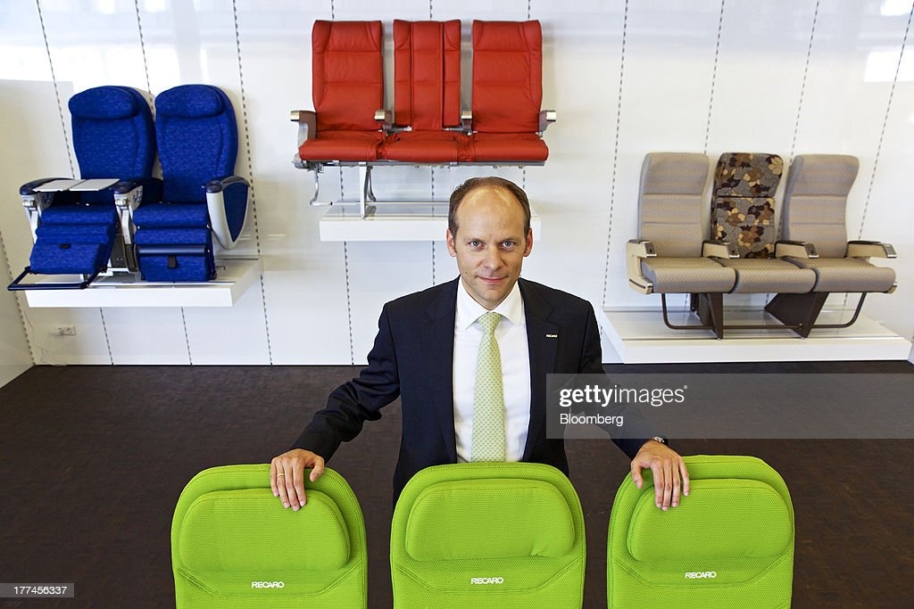 Mark Hiller, chief executive officer of Recaro Aircraft Seating GmbH & Co., poses for a photograph with a display of green Recaro BL3520 seats in the company's showroom in Schwabish Hall, Germany, on Thursday, Aug. 22, 2013. Germany's economic growth in the second quarter was driven by consumption and a rebound in investment as a recovery in the 17-nation euro area, its biggest trading partner, bolstered confidence. Photographer: Gianluca Colla/Bloomberg via Getty Images