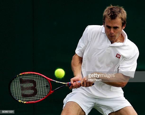 Mark Hilton of Great Britain in action during his first round match against Albert Costa of Spain at the Wimbledon Lawn Tennis Championship on June...