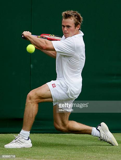 Mark Hilton of Great Britain in action during his second round match against Dominik Hrbaty of Slovakia at the Wimbledon Lawn Tennis Championship on...
