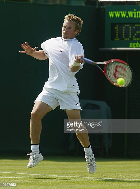 Mark Hilton of Great Britain plays a forehand against El Aynaoui Younes during the second day of the Wimbledon Tennis Championships at the All...