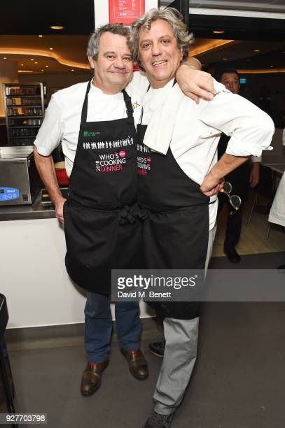 Mark Hix and Giorgio Locatelli pose in the kitchen at Who's Cooking Dinner 2018 a charity dinner featuring 20 of the capital's finest chefs cooking...