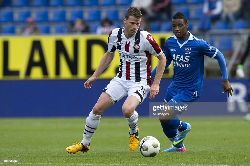 Mark Hocher of Willem II , Giliano Wijnaldum of AZ during the Dutch Eredivisie match between Willem II and AZ Alkmaar on May 12, 2013 at the Koning Willem II stadium in Tilburg, The Netherlands.