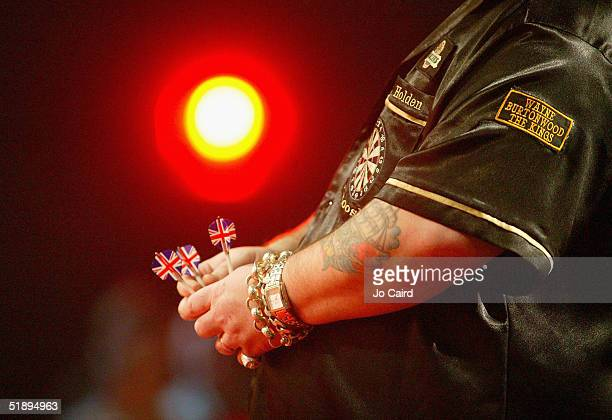 Mark Holden holds his darts during the 2005 Ladbrokescom World Darts Championship at The Circus Tavern on December 26 2004 in Purfleet England