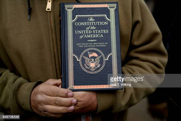 Mark holds a copy of the U.S. Constitution at a pro gun rally on April 21, 2018 in Boulder, Colorado. The city of Boulder is considering enacting an...