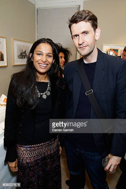 Mark Holgate and guest attend Vogue Voice of a Century book launch at Matches Fashion on September 20, 2016 in London, England.