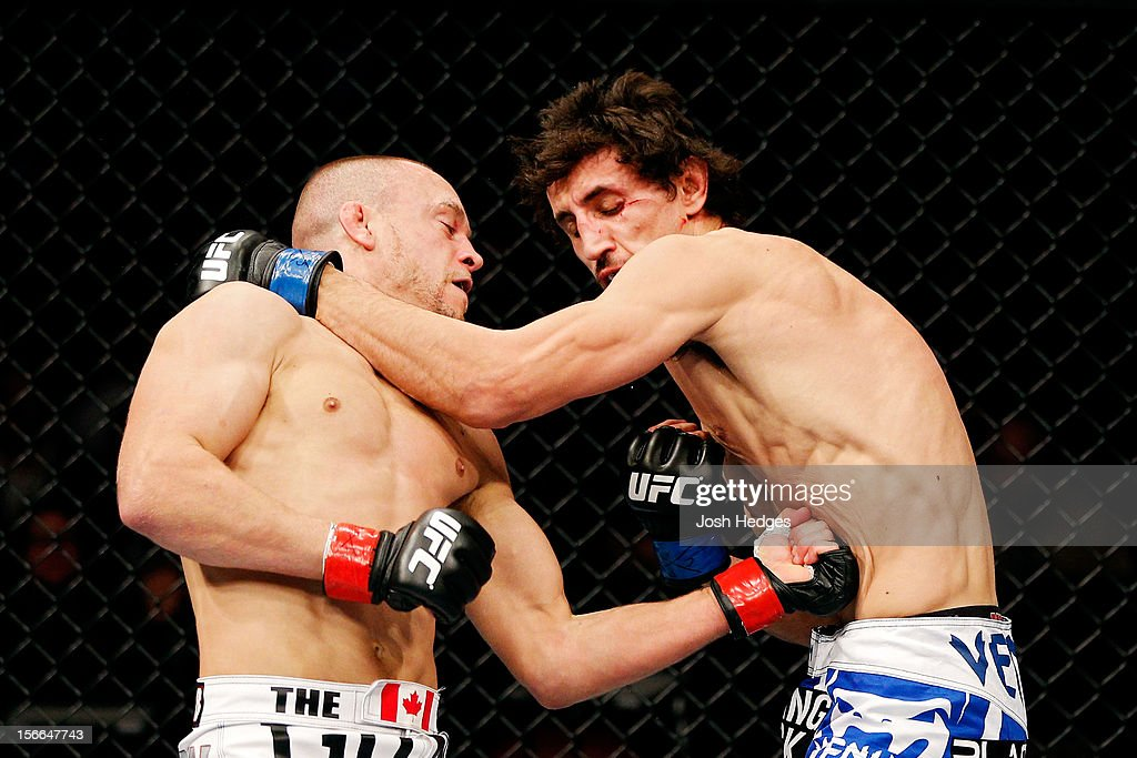 Mark Hominick connects on a punch to the body of Pablo Garza during
