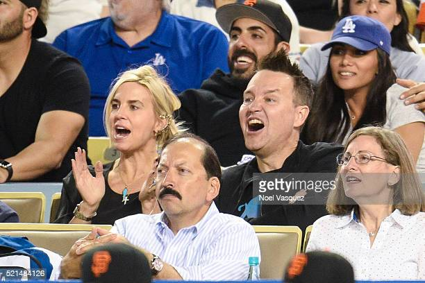 Mark Hoppus and Skye Everly attend a baseball game between the San Francisco Giants and the Los Angeles Dodgers at Dodger Stadium on April 16 2016 in...