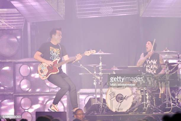 Mark Hoppus and Travis Barker of Blink-182 perform at The Forum on August 08, 2019 in Inglewood, California.